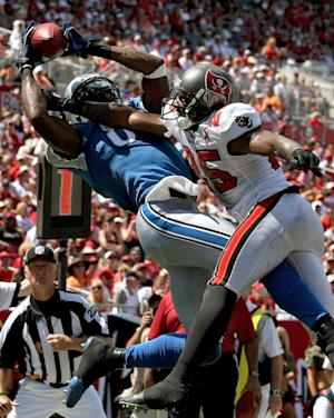 Detroit Lions wide receiver Calvin Johnson (81) pulls in a third-quarter touchdown pass in front of Tampa Bay Buccaneers defensive back Aqib Talib (25) during an NFL football game on Sunday, Sept. 11, 2011, in Tampa, Fla. (AP Photo/Margaret Bowles)