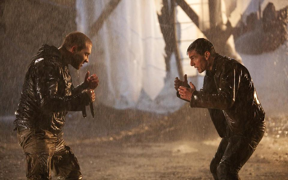 "This undated publicity photo released by Paramount Pictures shows Tom Cruise, right, as Reacher and Jai Courtney as Charlie in the film, ""Jack Reacher."" (AP Photo/Paramount Pictures, Karen Ballard)"