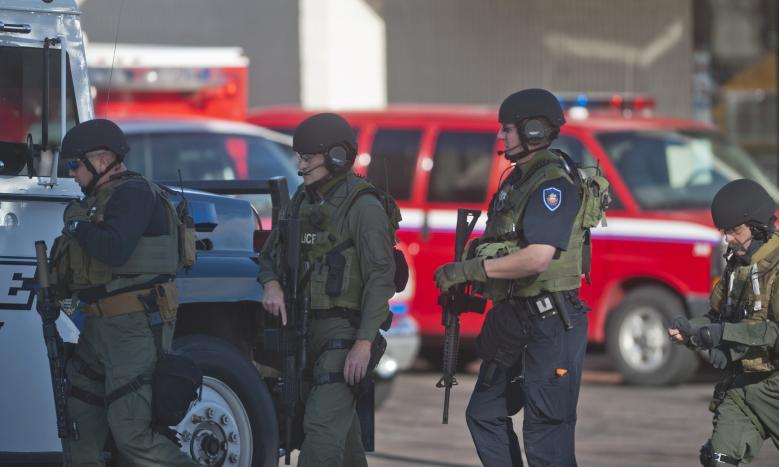 Armed law enforcement officers gather at Arapahoe High School, after a student opened fire in the school in Centennial, Colorado