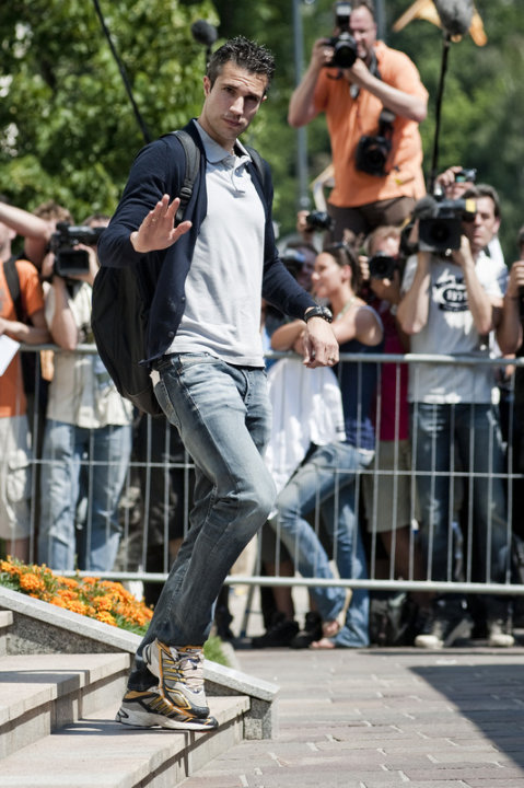 The Netherlands' National Football Team Player Robin Van Persie Waves As He Leaves The Sheraton Hotel In Krakow On June AFP/Getty Images