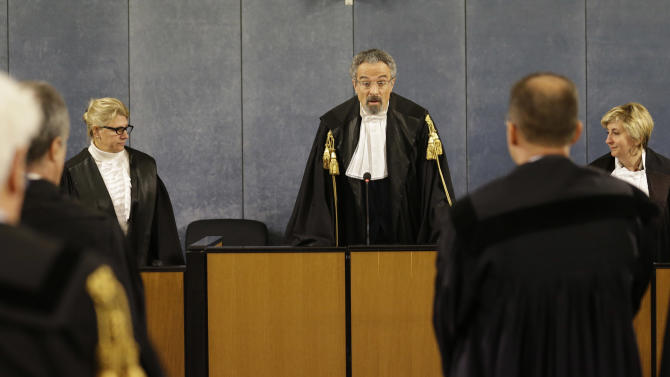 Court president Oscar Magi, center, reads a sentence in Milan's court, Italy, Thursday, March 7, 2013. A Milan court has convicted former Premier Silvio Berlusconi for the illegal publication of transcripts of wiretapped conversations in a newspaper owned by his media empire. The court on Thursday sentenced him to one year in jail, although he is unlikely to be put behind bars during a possible appeal. (AP Photo/Luca Bruno)
