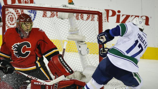 Miller wins Canucks debut, 4-2 over Flames