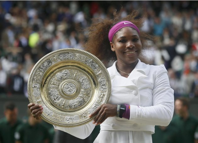Serena Williams of the U.S. holds her trophy after defeating Agnieszka Radwanska of Poland in their women's final tennis match at the Wimbledon tennis championships in London