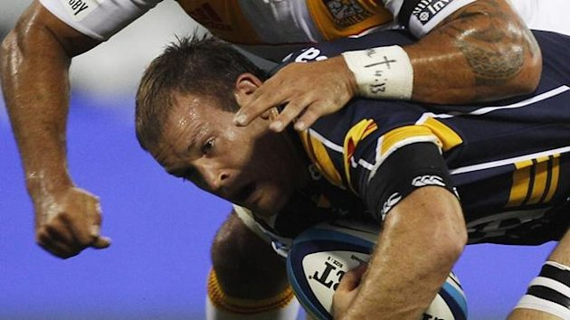 2011 Super Rugby Australia's ACT Brumbies Julian Salvi (bottom) is tackled by New Zealand Waikato Chiefs Liam Messam
