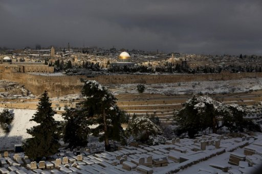 A general view from the Jewish cemetery at the Mount of Olives shows the snow-covered old city of Jerusalem on January 10, 2013. US President Barack Obama is expected to arrive in Jerusalem on March 20 for a three-day trip which will also take him to the West Bank city of Ramallah, media reports and a Palestinian official said