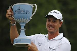 Stenson of Sweden poses with the trophy after winning the 2013 Deutsche Bank Championship golf tournament in Norton, Massachusetts
