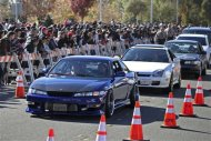 "Vehicles are driven past a crowd attending an unofficial memorial event for ""Fast & Furious"" star Paul Walker in Santa Clarita, California December 8, 2013. REUTERS/Jonathan Alcorn"
