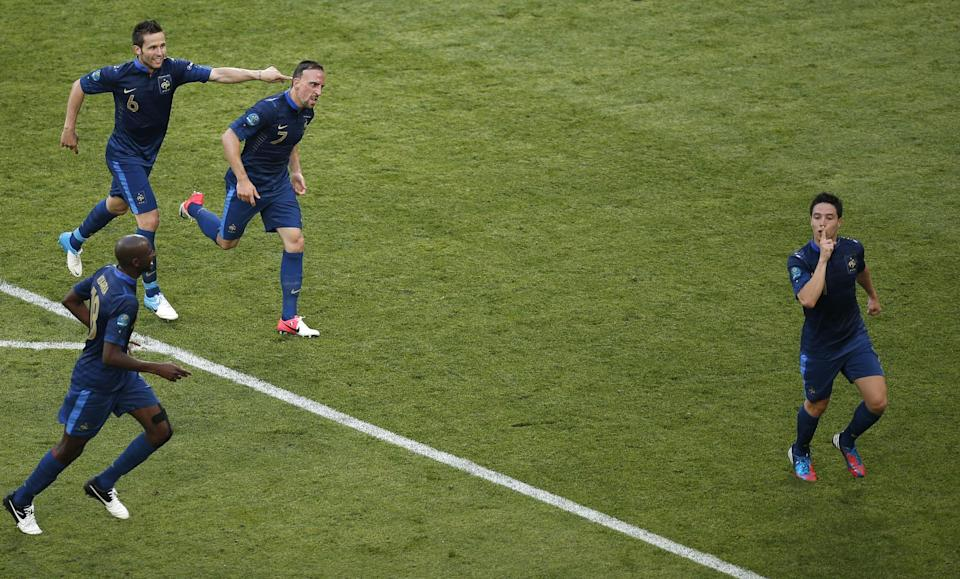 France's Samir Nasri, right, celebrates scoring his side's first goal during the Euro 2012 soccer championship Group D match between France and England in Donetsk, Ukraine, Monday, June 11, 2012. (AP Photo/Vadim Ghirda)