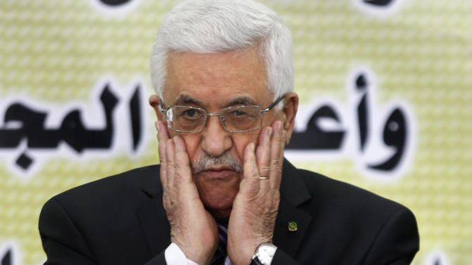 Palestinian President Mahmoud Abbas prays during a meeting of the Fatah revolutionary council in the West Bank city of Ramallah, Sunday, Sept. 1, 2013. Israeli and Palestinian officials said a planned meeting between lawmakers and the Palestinian president was postponed. The Israeli lawmakers had planned on traveling to President Mahmoud Abbas' West Bank headquarters on Tuesday. The lawmakers belong to a new caucus formed to support recently relaunched peace talks. (AP Photo/Majdi Mohammed)