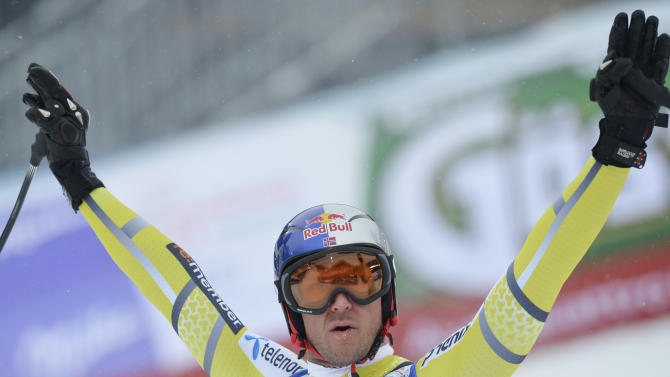 Norway's Aksel LundSvindal celebrates after his run of the men's downhill  at the Alpine skiing world championships in Schladming, Austria, Saturday, Feb. 9, 2013. (AP Photo/Kerstin Joensson)