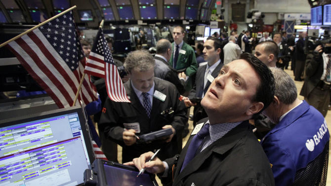 Traders work on the floor of the New York Stock Exchange, Monday, April 16, 2012, in New York. The Dow Jones industrial average rose but other stock indexes fell early Monday as a strong report on retail sales didn't dispel worries about the economy. (AP Photo/Richard Drew)