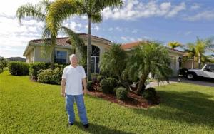 Robert Davidson stands in front of the home he purchased in 2011 in a golf course community in Naples, Florida
