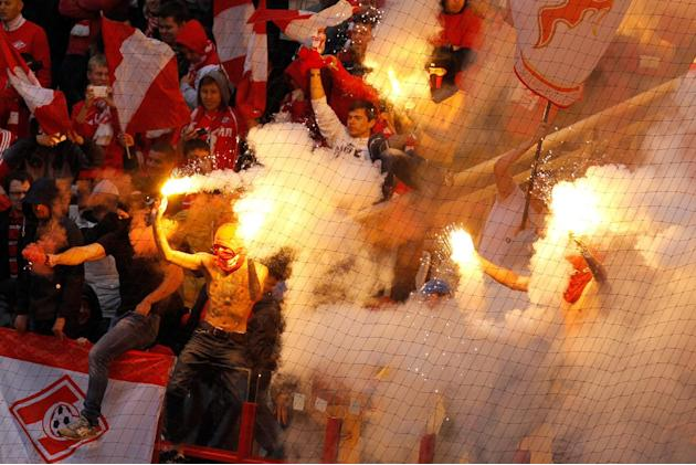 Spartak fans burn flares while celebrating their team's goal against CSKA during a Russian Premier League Championship soccer match between CSKA Moscow and Spartak Moscow at the Lokomotiv stadium in M