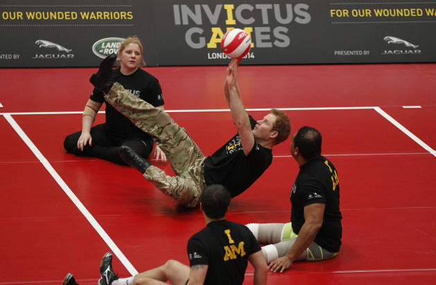 Britain Prince Harry, center, plays a game of sitting volleyball during the launch of the Invictus Games for wounded warriors at the Copper Box arena in the Queen Elizabeth Olympic Park in London, Thu