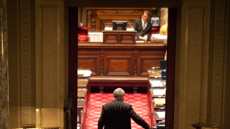 Greg Hanson, who goes by the name Sir Odin, looks into the state Senate chamber, emptied for a two-hour recess, before the Senate came back to debate the Minnesota Vikings stadium bill Tuesday, May 8, 2012, in St. Paul, Minn. (AP Photo/Star Tribune, Glen Stubbe) ST. PAUL OUT  MINNEAPOLIS-AREA TV OUT   MAGS OUT