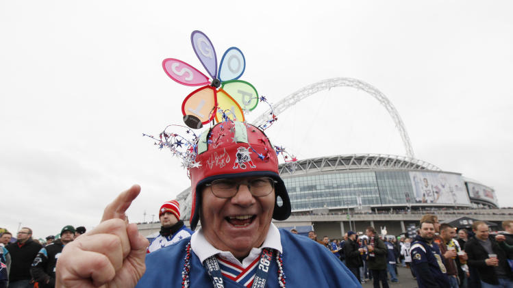 "Fan Jack ""Bo"" Kennedy waits outside the stadium before the NFL football game between the St. Louis Rams and the New England Patriots at Wembley Stadium in London"