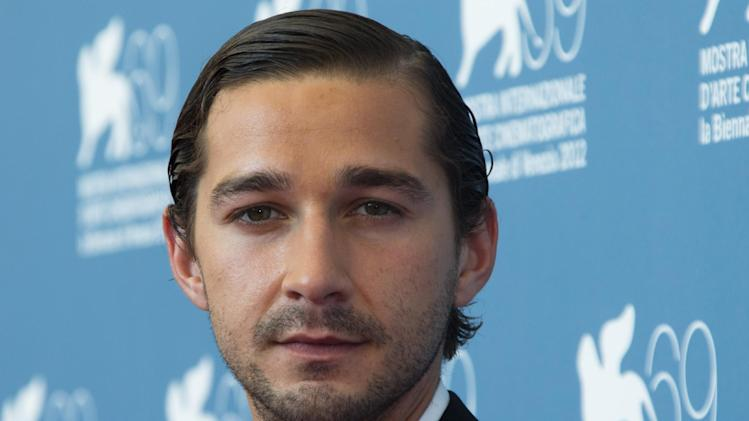 "FILE - In the Sept. 6, 2012, file photo, actor Shia LaBeouf poses at the 69th edition of the Venice Film Festival in Venice, Italy. LaBeouf debuted his short film, ""Howard Cantour.com,"" online on Monday, Dec. 16, 2013, but unfortunately failed to credit the source of his idea for the project. LaBeouf's short began to circulate in late 2012 at festivals like Cannes Film Festival and the Cleveland and Seattle International Film Festivals. The short, which stars Jim Gaffigan, examines the life of an anguished online film critic, which stemmed from the concept of a 2007 graphic novella by artist Daniel Clowes titled ""Justin M. Damiano."" Clowes' tale also depicts the life of a film reviewer. LaBeouf took to Twitter on Monday evening to acknowledge and apologize for plagiarizing Clowes' work. But viewers didn't pinpoint the connection to Clowes' novella until its release online on Monday. (AP Photo/Joel Ryan, File)"