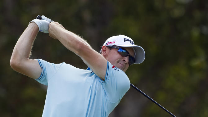 Scott Langley drives off the first tee during the second round of the Sony Open golf tournament on Friday, Jan. 11, 2013, in Honolulu. (AP Photo/Marco Garcia)