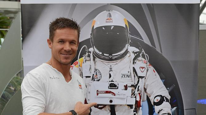 Austria's Felix Baumgartner poses for photgraphers after  a press conference in Salzburg, on Saturday Oct. 27, 2012  in Austria. Supersonic skydiver Felix Baumgartner has finally come home after his death-defying, record-breaking leap from the edge of space.  The Austrian former military parachutist faced reporters in his home city of Salzburg on Saturday, nearly two weeks after his plunge from a balloon to the New Mexico desert made him the first person to reach supersonic speed without traveling in a jet or spacecraft.   (AP Photo/Kerstin Joensson)