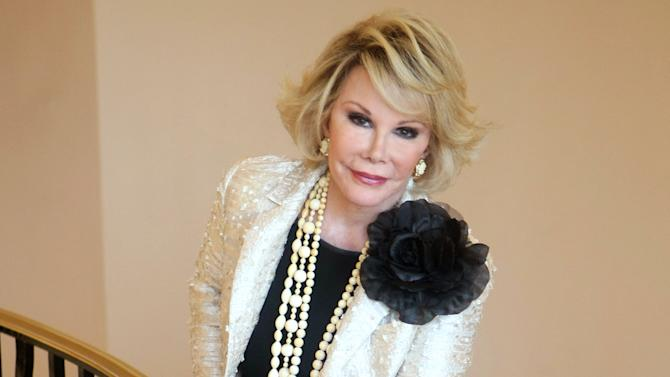 """FILE - This Oct. 5, 2009 file photo shows Joan Rivers posing as she presents """"Comedy Roast with Joan Rivers """" during the 25th MIPCOM (International Film and Programme Market for TV, Video, Cable and Satellite) in Cannes, southeastern France. Rivers, who died Sept. 4 at age 81, is the opening act for """"Eating Delancey: A Celebration of Jewish Food."""" Set to be published in December by powerHouse Books, """"Eating Delancey"""" is a tribute to knishes, bagels, pickles and other staples of the Jewish immigrant community of Manhattan's Lower East Side. She provides some family stories and some Jewish jokes in the introduction.  (AP Photo/Lionel Cironneau, File)"""