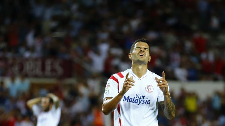 "Sevilla's Victor Machin ""Vitolo"" reacts after missing a scoring opportunity against Valencia during their soccer match in Seville"