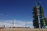 A Long March 2F rocket carrying the Shenzhou 9 rocket rolls out to the launch pad at China's Jiuquan Satellite Launch Center ahead of a planned June 2012 launch of the country's first manned space docking mission.