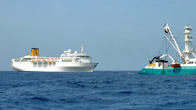 RETRANSMISSION TO PROVIDE ALTERNATIVE CROP - In this photo taken by a member of French fishing vessel, The Talenduic, and provided by the Prefecture of the Reunion Island, shows the Italian cruise ship, The Costa Allegra, left, being towed by French fishing vessel, The Trevignon, in the Indian Ocean, Tuesday, Feb. 28, 2012. The French fishing vessel The Trevignon  on Tuesday began towing an Italian cruise ship drifting powerless in the Indian Ocean to a nearby Seychelles island, but was not expected to reach the tiny resort island until Wednesday, officials said.  Seychelles authorities said they are making arrangements to evacuate people to the island of Desroches and then to transfer the more than 1,000 passengers and crew members to the main Seychelles island of Mahe by plane and fast boats. (AP Photo/Le Talenduic, Reunion Island Prefecture, HO)