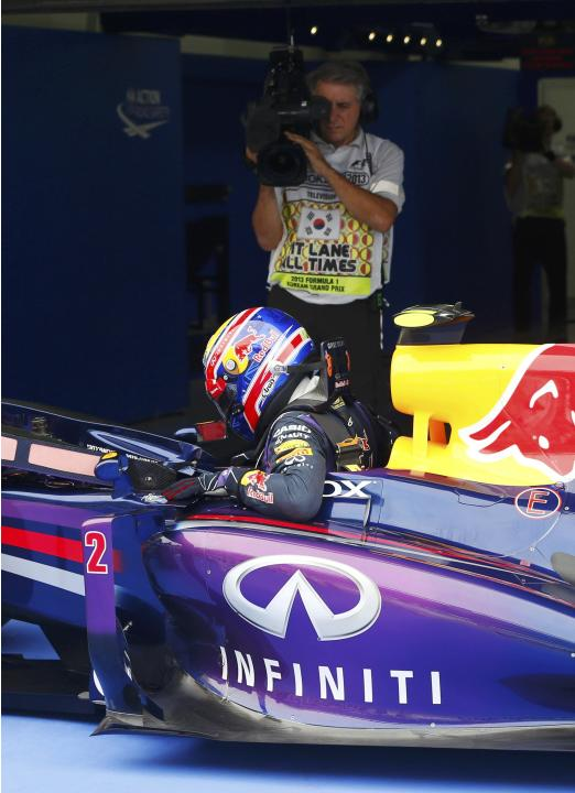 Red Bull Formula One driver Webber gets out of his car after the qualifying session for the Korean F1 Grand Prix in Yeongam