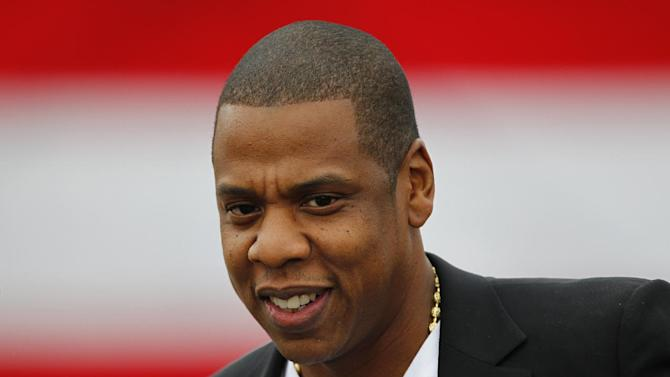 "FILE - This May 14, 2012 file photo shows entertainer Shawn ""Jay-Z"" Carter at the Philadelphia Museum of Art, in Philadelphia. Jay-Z's ""My President Is Black (Remix)"", is at the top of Spotify's Top 10 viral tracks in the United States and the United Kingdom from Monday, Nov. 5, 2012 to Sunday, Nov. 11, 2012 via Facebook, Tumblr, Twitter and Spotify. (AP Photo/Matt Rourke, File)"