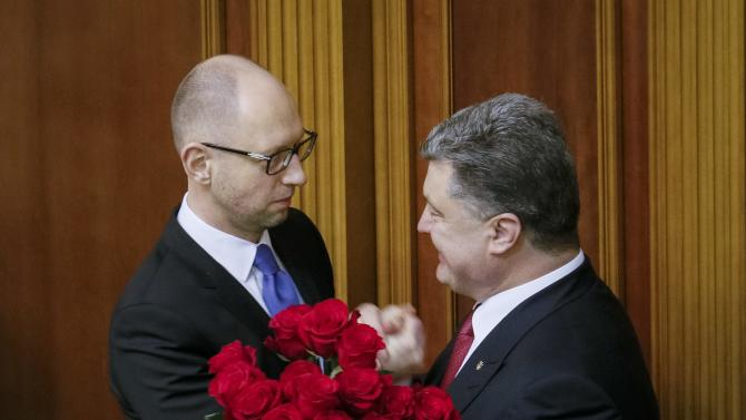 Ukraine's President Poroshenko congratulates newly appointed Prime Minister Yatseniuk during a parliament session in Kiev