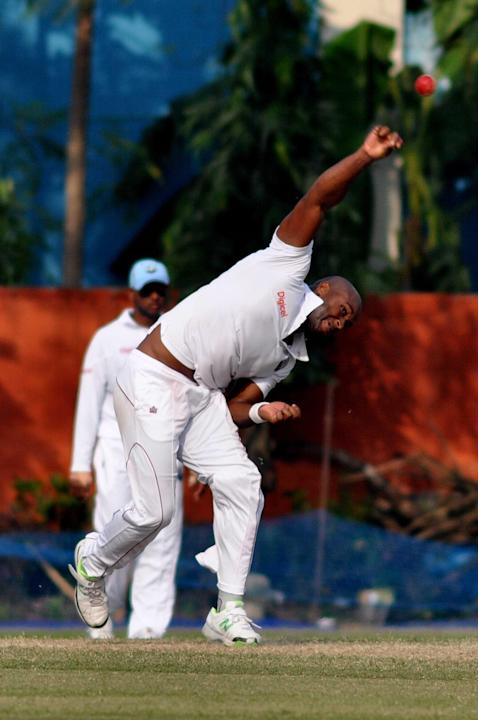 West Indies player T Best in action during Day 2 of practice match between West Indies and Uttar Pradesh Cricket Association XI at the Jadavpur University Ground in Kolkata on Nov.1, 2013. (Photo: IAN