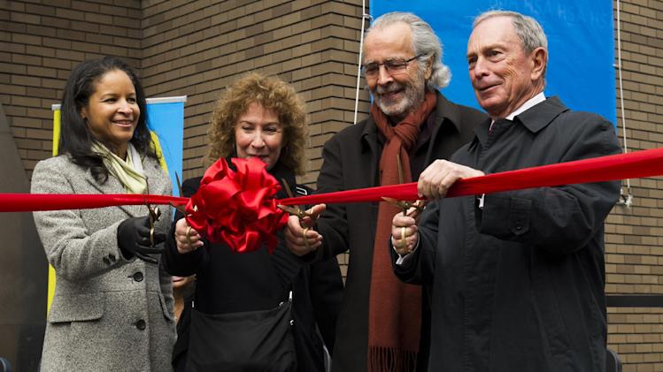 """From left to right, Yvette L. Campbell, Lani Hall, Herb Albert and Mayor Michael R. Bloomberg cut the ribbon to officially open the """"Harlem School of the Arts - The Herb Alpert Center"""" building on Monday, March 11, 2013 in New York. (Photo by Charles Sykes/Invision for Harlem School of the Arts/AP Images)"""