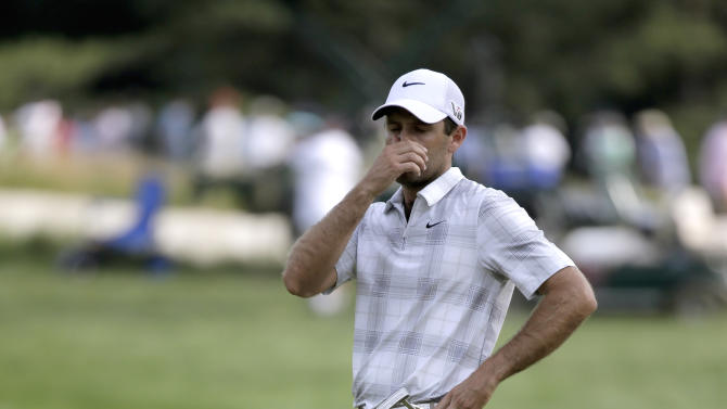 Charl Schwartzel, of South Africa, reacts to missed putt on the 12th hole during the third round of the U.S. Open golf tournament at Merion Golf Club, Saturday, June 15, 2013, in Ardmore, Pa. (AP Photo/Morry Gash)