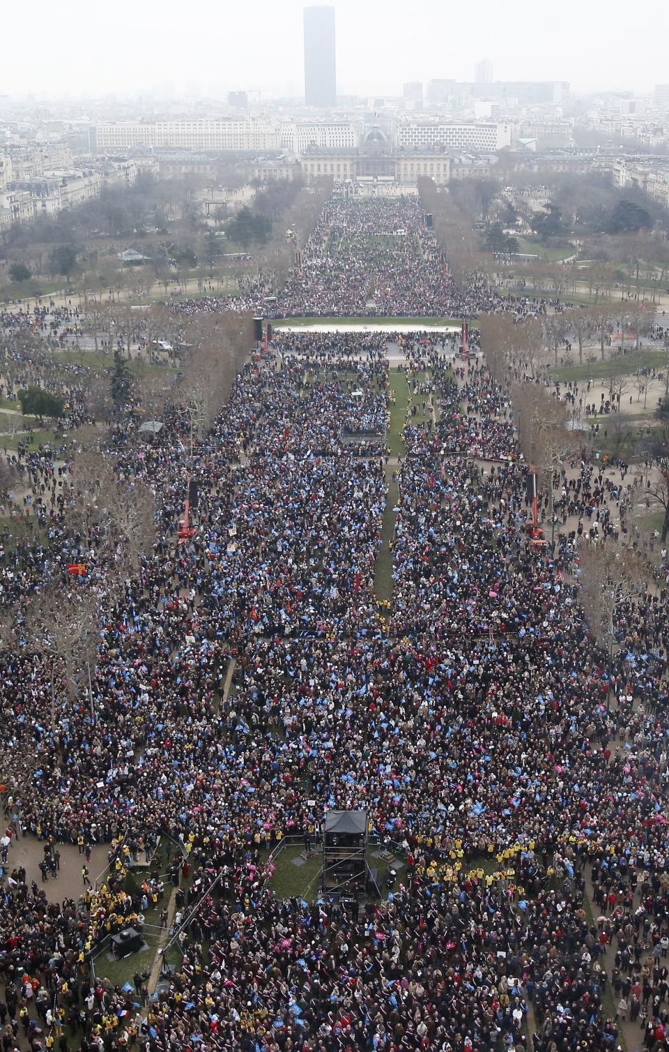 "In this over-head view made from the Eiffel Tower, some thousands of people gather on the ""Champs de Mars"", in Paris, Sunday, Jan. 13, 2013.  Protesters are mobilizing against the French president's plan to legalize gay marriage, streaming into Paris by bus, car and train.  (AP Photo/Michel Euler)"