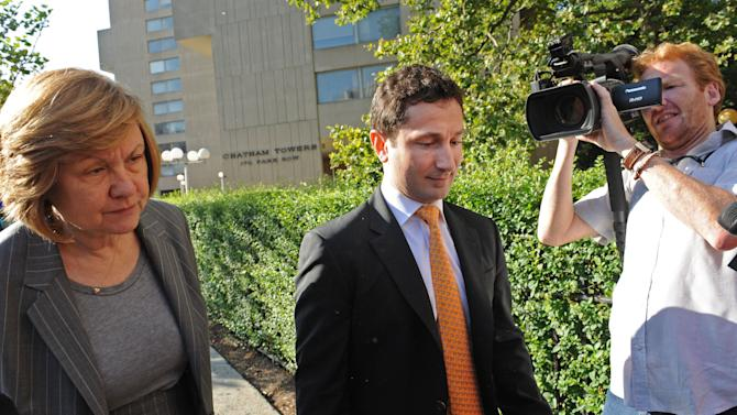 Former Goldman Sachs Group Inc. executive Fabrice Tourre, center, enters Manhattan federal court on the first day of his trial, Monday, July 15, 2013, in New York. Tourre is accused of misleading investors about the true prospects of their bet on a package of mortgage-based securities. (AP Photo/Louis Lanzano)