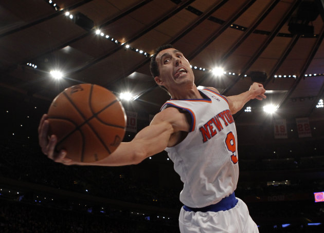 Knicks' Prigioni saves the ball from going out of bounds against the New Orleans Hornets in the second half of their NBA basketball game at Madison Square Garden in New York