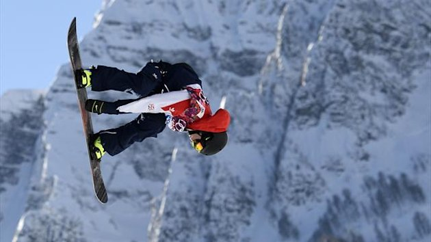 Britain's Jamie Nicholls performs a jump during the men's slopestyle snowboarding qualifying session at the 2014 Sochi Olympic Games (Reuters)