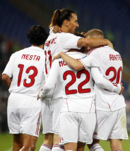 AC Milan's Zlatan Ibrahimovic, of Sweden, second from left, celebrates with his teammates after scoring during the Serie A soccer match between AS Roma and AC Milan, in Rome's Olympic stadium, Saturday, Oct. 29, 2011. (AP Photo/Andrew Medichini)