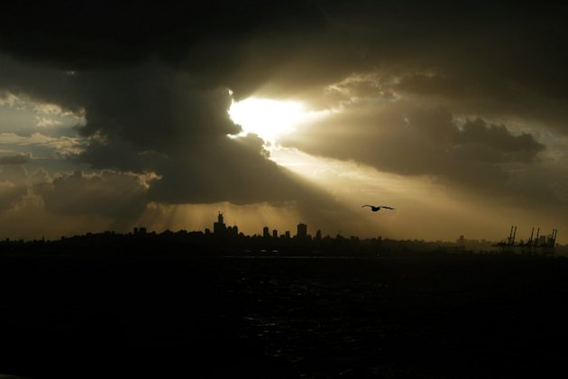 Heavy clouds cover the skies over the Lebanese capital, Beirut on January 7, 2013. Stormy weather, including high winds and heavy rainfall, lashed the eastern Mediterranean coast, downing power lines