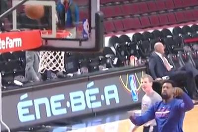 DeAndre Jordan practices free throws by trying to bank them in