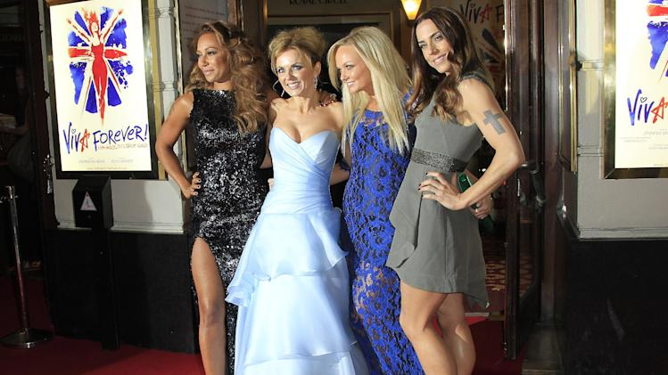 From left, Mel B, Geri Halliwell, Emma Bunton and Mel C pose for photographs as they arrive for the press showing of Viva Forever!, a musical based on the songs of the Spice Girls, at a theater in central London, Tuesday, Dec. 11, 2012. (Photo by Joel Ryan/Invision/AP)