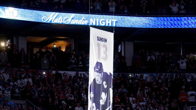 Toronto Maple Leafs players watch as former Maple Leafs captain Mats Sundin's No. 13 is raised to the rafters prior to an NHL hockey game between the Maple Leafs and the Montreal Canadiens in Toronto on Saturday, Feb. 11, 2012. (AP Photo/The Canadian Press, Frank Gunn)