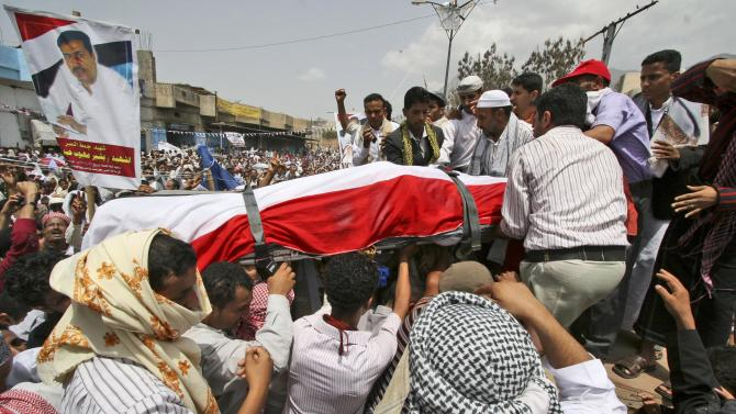 Anti-government protestors carry the body of a demonstrator who was killed recently in clashes with Yemeni security forces, during his funeral procession in Taiz, Yemen, Friday, June 17, 2011. A ruling party official says Yemen's president plans to return home in days after surviving an attack on his palace. (AP Photo/Anees Mahyoub)