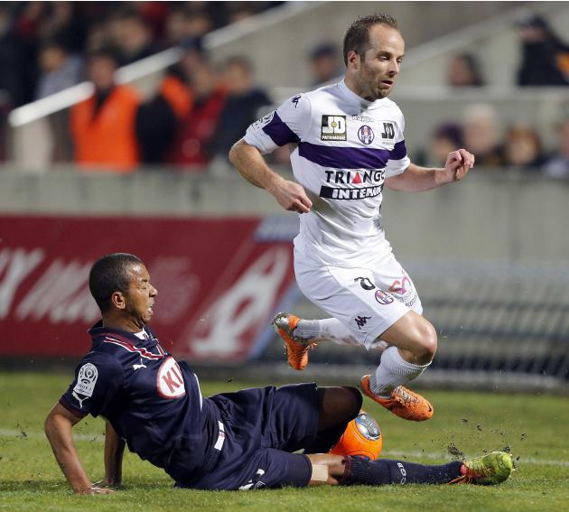 Mariano Ferreira Filho of Girondins Bordeaux fights for the ball with Etienne Didot of Toulouse during their French Ligue 1 soccer match at the Chaban Delmas Stadium in Bordeaux