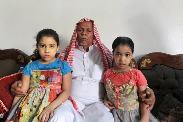 The daughters of Mohammed al-Huraisi are seen with his father Ali Abdullah al-Huraisi at their home on the outskirts of Riyadh