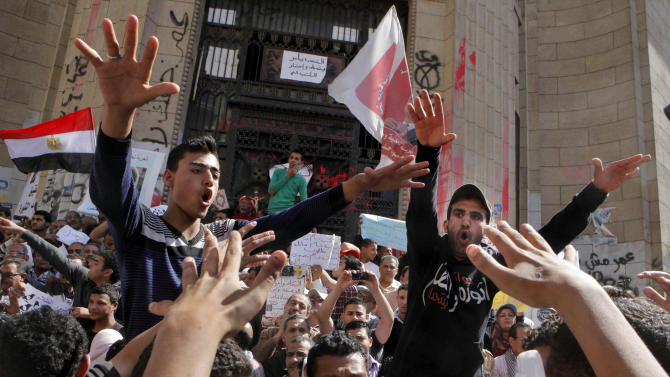 Egyptian protesters shout anti-President Mohammed Morsi slogans during a protest in front of the prosecutor general's office in Cairo, Egypt, Friday, March 29, 2013. Hundreds of activists demonstrated to show solidarity with political activists charged by the prosecutor general with inciting violence during last week's clashes near the Muslim Brotherhood's Cairo headquarters. (AP Photo/Amr Nabil)