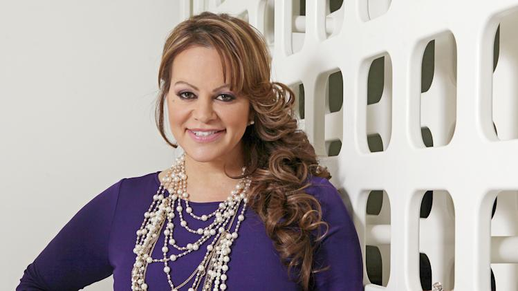 FILE - In this March 8, 2012, file photo, Mexican-American singer and reality TV star Jenni Rivera poses during an interview in Los Angeles. The family of Rivera, who died in a plane crash in December,  are expected to file a lawsuit against the operator of the private jet company. (AP Photo/Reed Saxon, file)