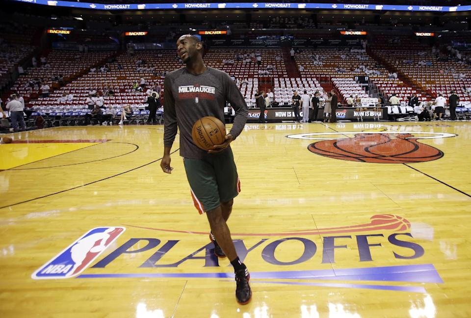 Milwaukee Bucks power forward Luc Richard Mbah a Moute practices before Game 1 of their first-round NBA basketball playoff series against the Miami Heat in Miami, Sunday, April 21, 2013. (AP Photo/Alan Diaz)