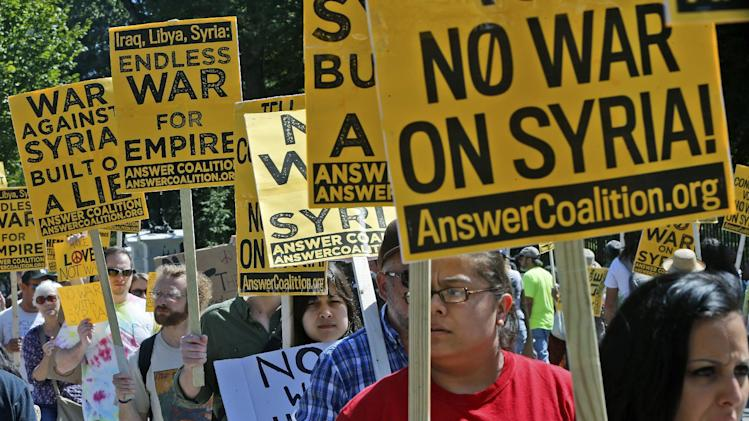 Anti-war demonstrators in Washington protest against possible U.S. military action in Syria in front of the White House Saturday, Sept. 7, 2013. (AP Photo/Charles Dharapak)
