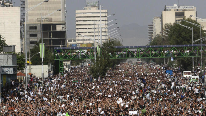 In this Monday, June 15, 2009 photo, hundreds of thousands of supporters of leading opposition presidential candidate Mir Hossein Mousavi, who claims there was voting fraud in Friday's election, turn out to protest the result of the election at a mass rally in Azadi (Freedom) St. in Tehran, Iran. Elections to pick Iran's next president are still five months away, but that's not too early for some warning shots by the country's leadership. The message to anyone questioning the openness of the June vote: Keep quiet. (AP Photo/Vahid Salemi)